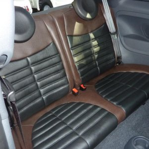 Rear seats reworked in black graphite colored leather