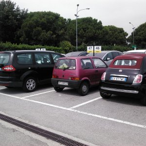 Two Fiats in the rental car park at the Venice airport.  Obviously the one of the left was not for rent!
